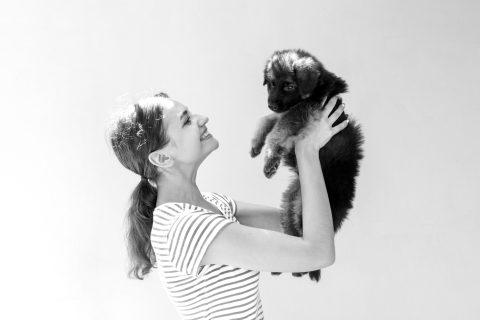 Klaver holding puppy